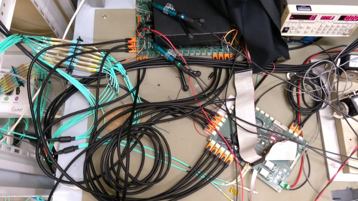 Theta-carrier connected to the VLDB board from CERN and to our back end server setup with 48 fiber optic links